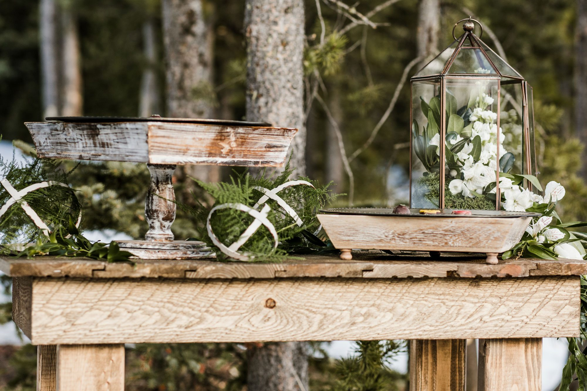 A winter tablescape with wood, metal, white florals & greenery accents