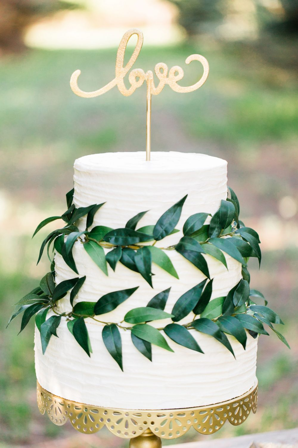 Simple cake with gold and greenery