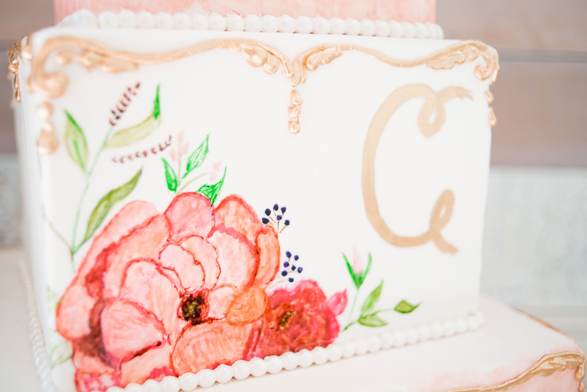 Hand-drawn floral cake in pink & gold