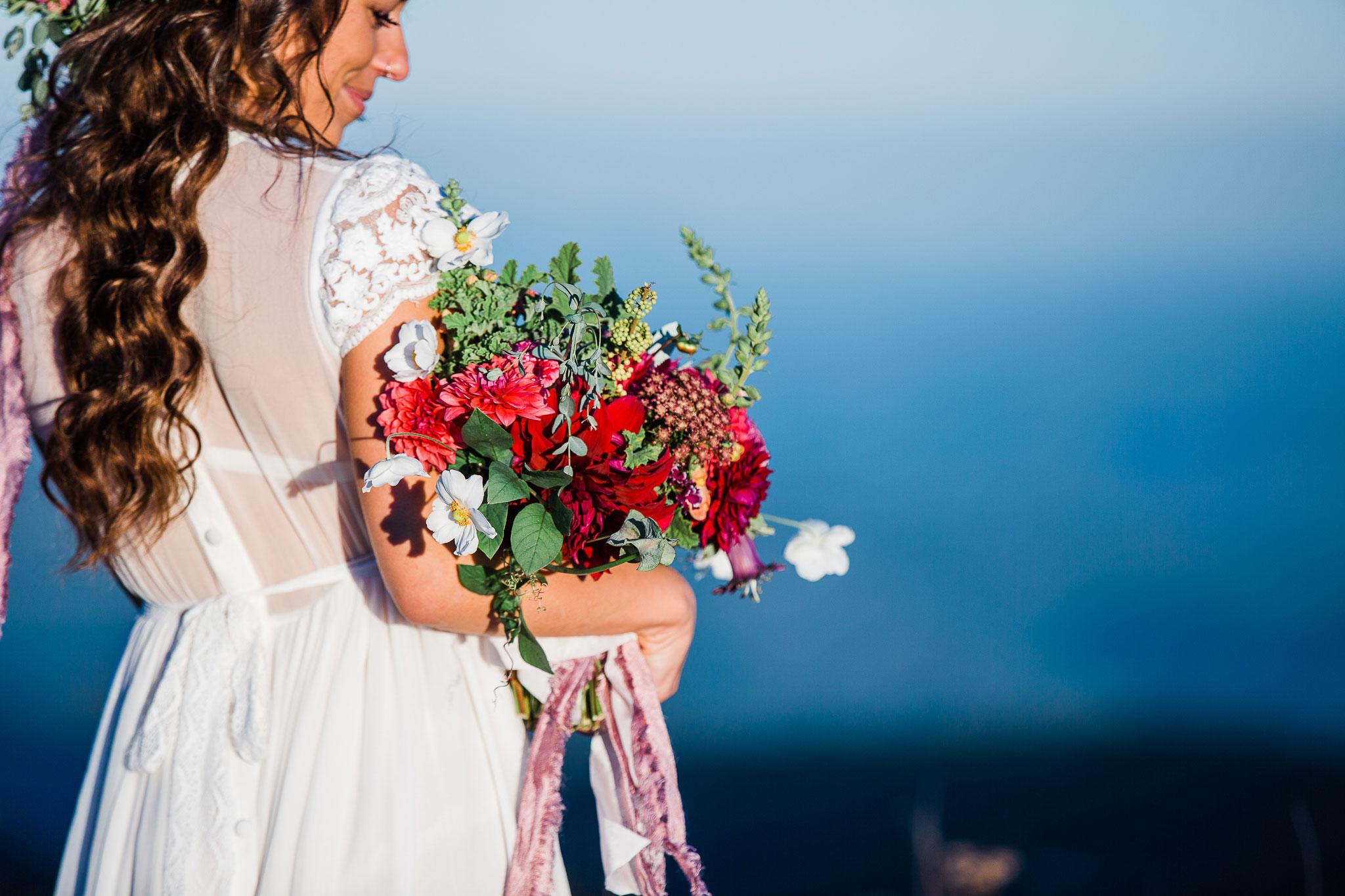 Boho bride with lush floral bouquet in the Blue Ridge Mountains.