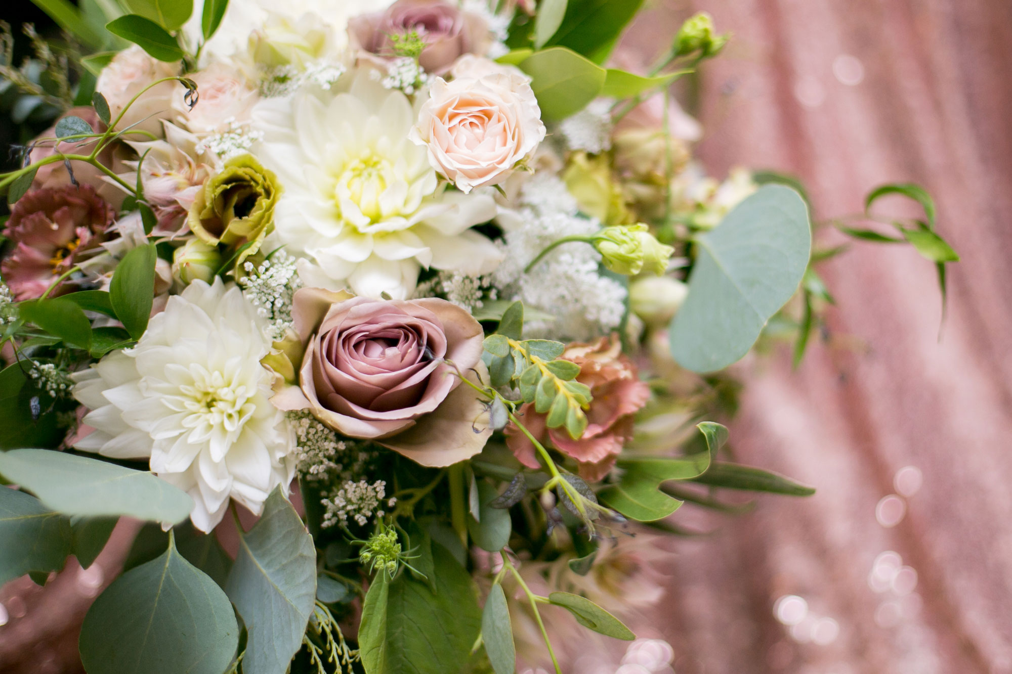A romantic floral bouquet with rose gold accents