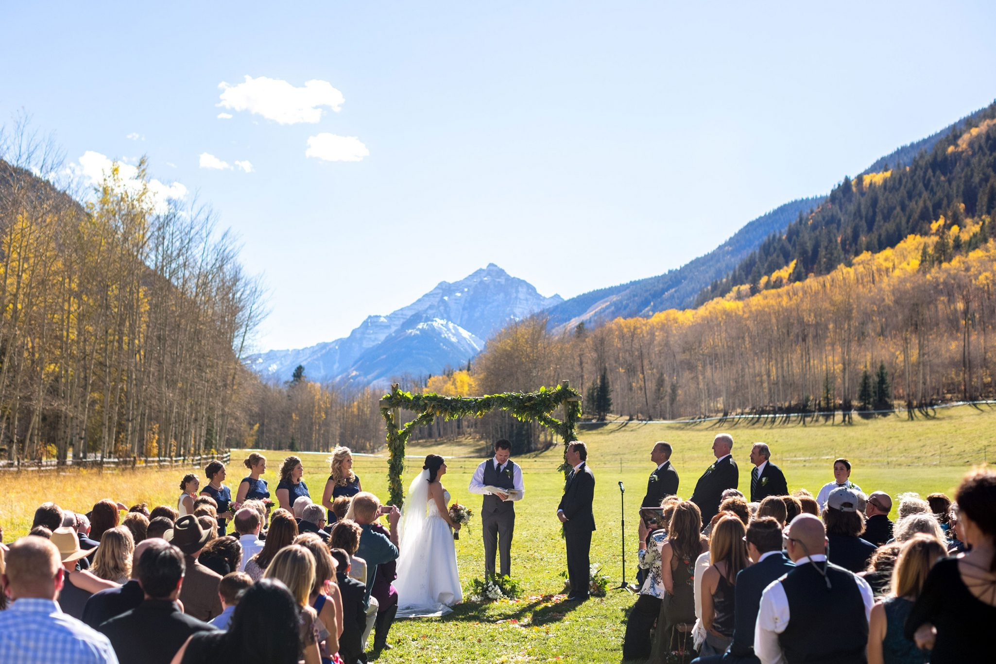 Outdoor mountain ceremony | A Fall Aspen Wedding at T Lazy 7 Ranch, Colorado