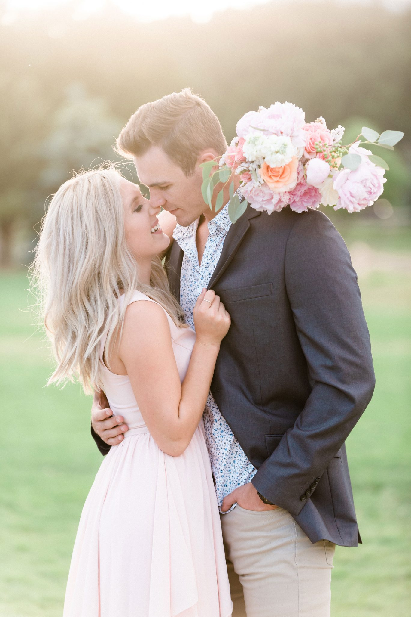 A Romantic Lakeside Engagement Shoot with a Canoe in Colorado