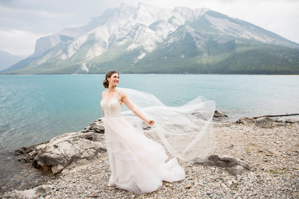 Bride in the wind | A Beautiful Mountain Wedding in Banff, Alberta,Canada