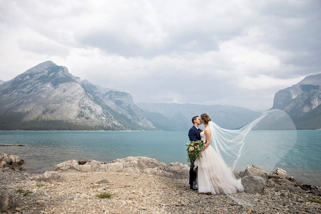 Bride + Grom kiss | A Beautiful Mountain Wedding in Banff, Alberta,Canada