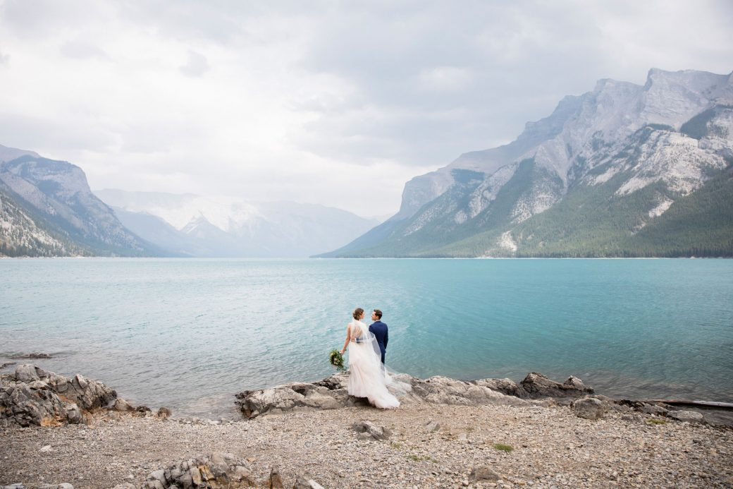 Mountain bride & groom lakeside | A Beautiful Mountain Wedding in Banff, Alberta,Canada