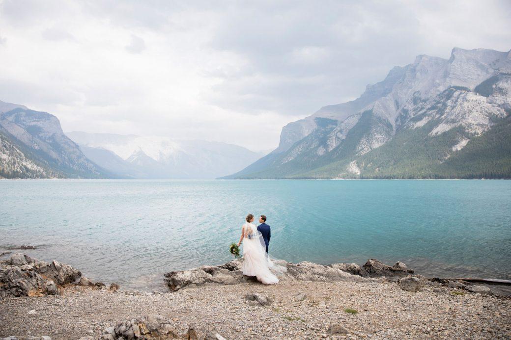 Mountain bride & groom lakeside | A Beautiful Mountain Wedding in Banff, Alberta,Canada