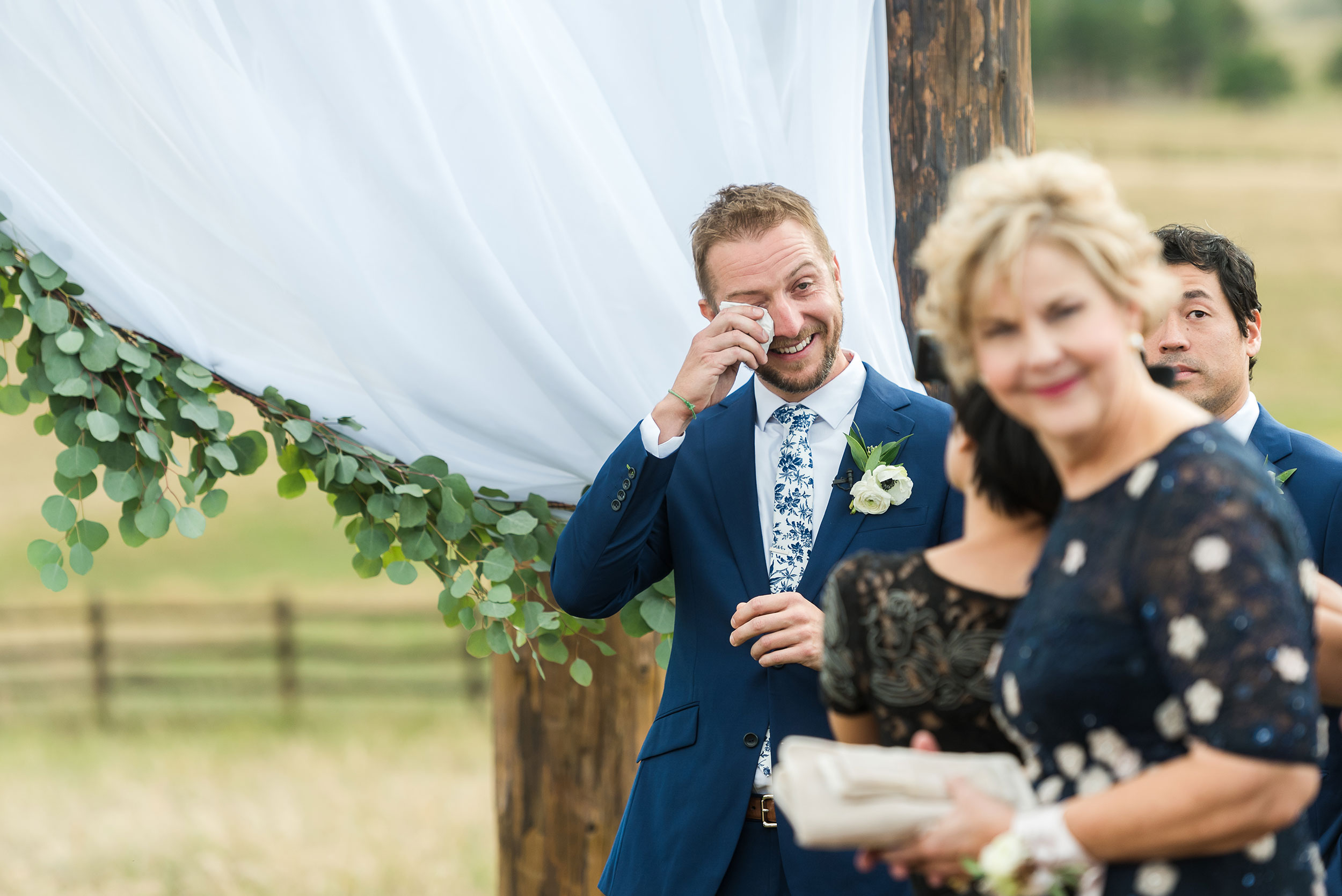 Grooms first look as bride walks down the aisle | Luxe Mountain Weddings