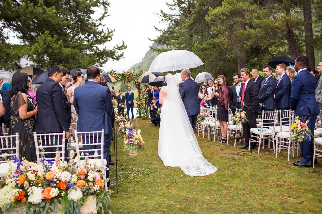 Walking down the aisle with dad in the rain | Luxe Mountain Weddings