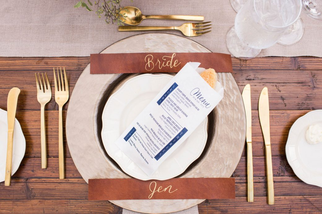 Place settings with leather and bread | Luxe Mountain Weddings