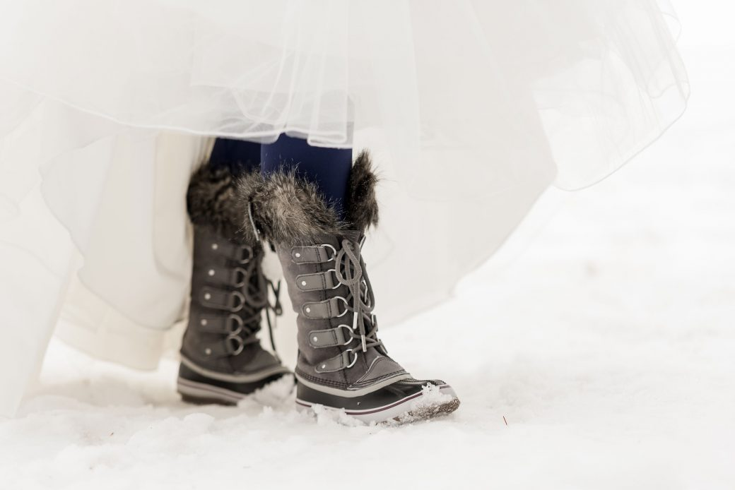 Bride in snow boots