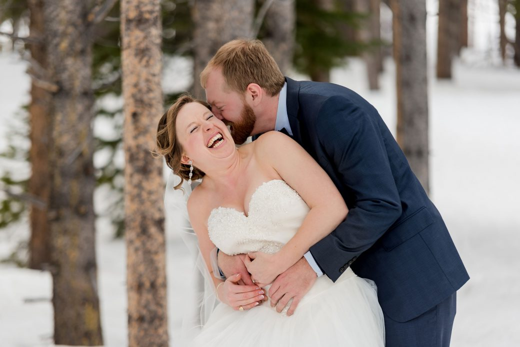 Happy bride & groom in the snow
