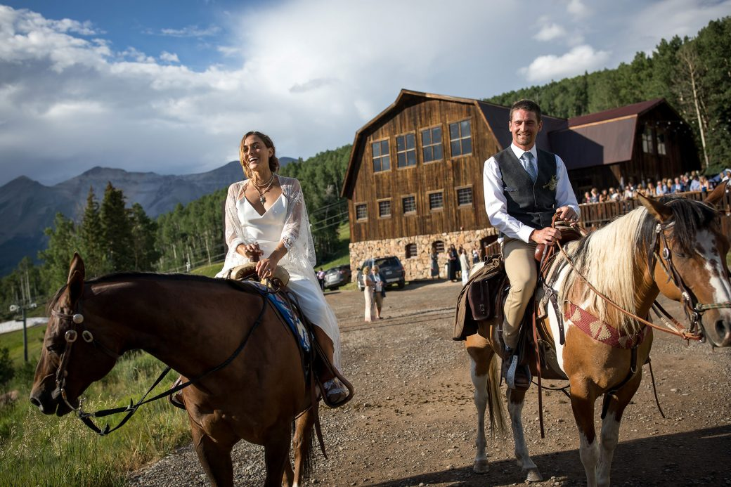 Bride & Groom on horseback after the ceremony in Telluride, CO