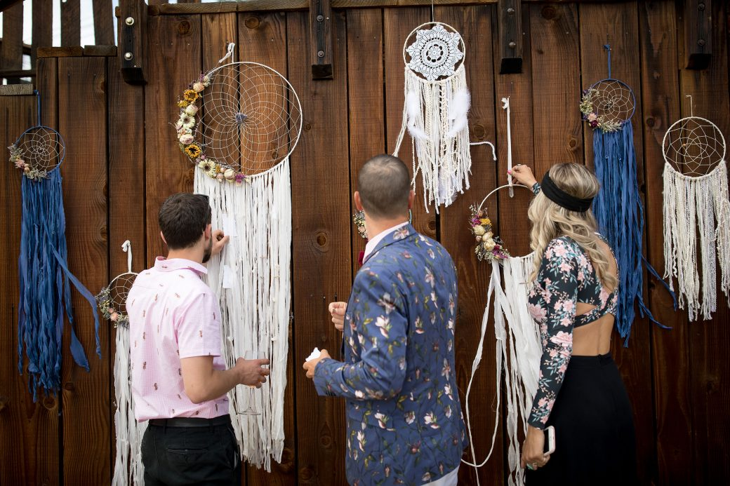 Guests were guided to the tables by looking at their names written on tattered paper hanging on the handmade flowing dreamcatchers