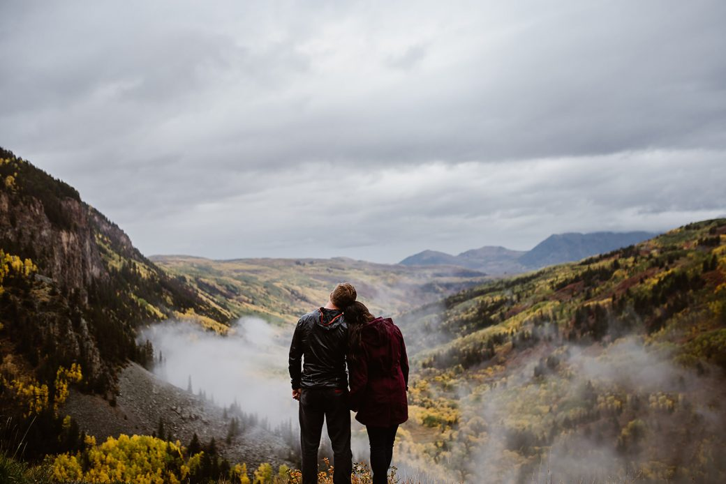 Engaged couple in the mountains in fall