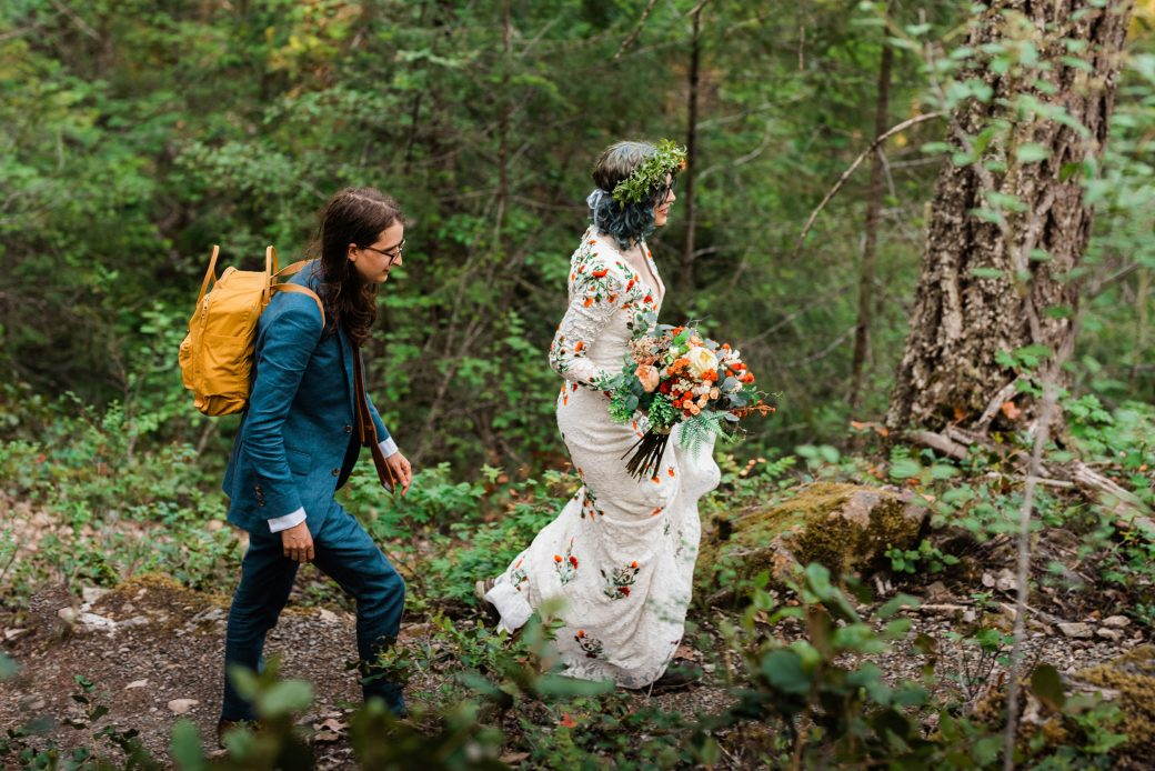 Bride hiking in the mountains