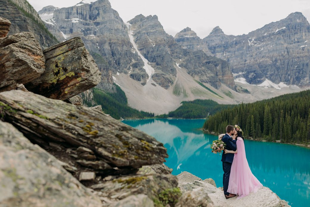 Bride and groom kissing at Moraine Lake