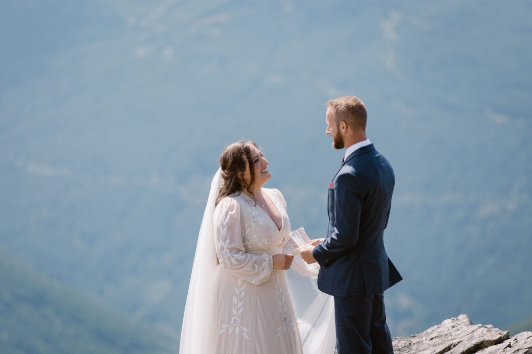 Bride & groom reciting vows on a mountaintop.