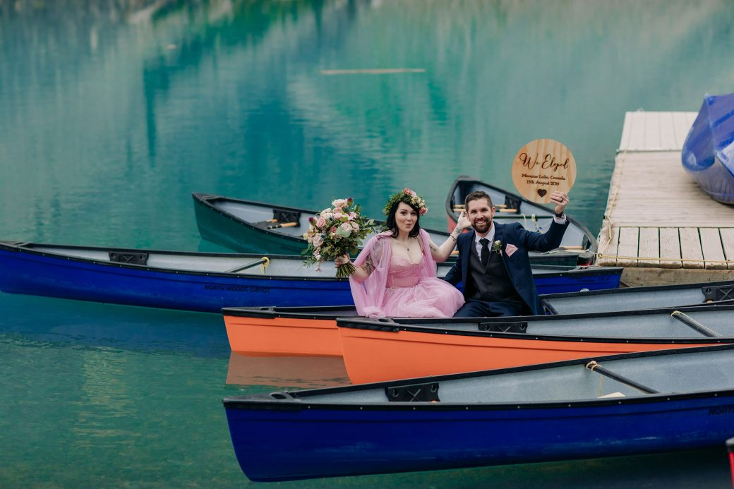 Bride & groom in canoes at Moraine Lake.